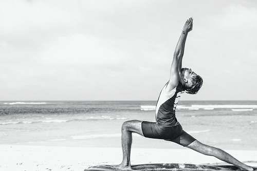 exercise man stretching on seashore yoga