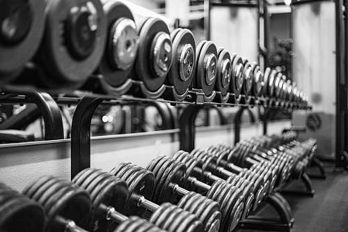 black-and-white gray scale photo of dumbbells factory