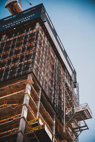 construction low angle photography of building scaffolding