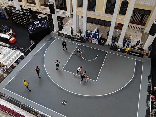 grey man playing basketball on gray court basketball hoop