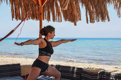 human woman doing yoga pose person