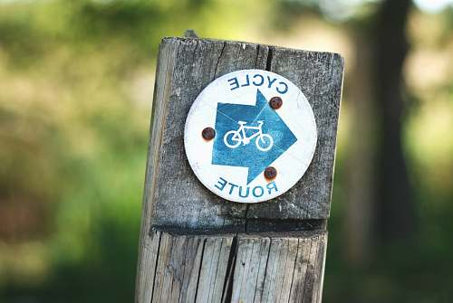 bike cycle route sign on a wooden post cycling