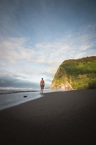 fitness man in beach jogging
