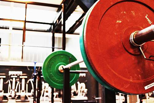 red red and green barbell on rack word
