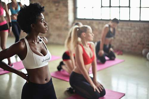 people woman wearing sport bra standing on gym floors yoga