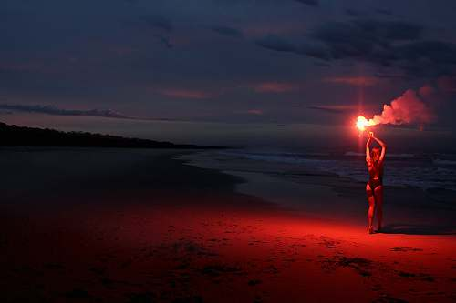nature woman standing while holding firecrackers light
