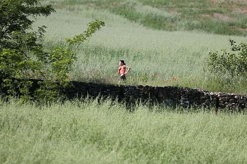 outdoors woman running through grass field