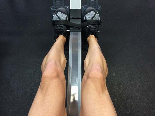 row person sitting on rowing machine crosstraining