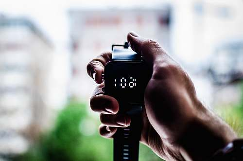 photo watch person holding digital watch digital free for commercial use images