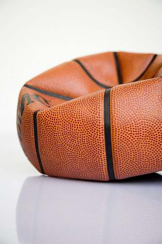 accessory brown basketball ball on white surface purse
