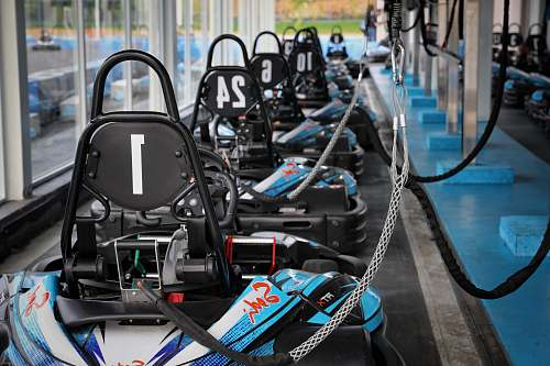 person blue and black kart on track side exercise