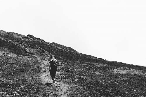 person grayscale photography of person hiking during daytime black-and-white