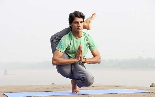 person man doing yoga people