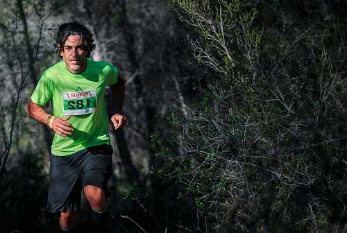 person man in green t-shirt running with 182 numbered shirt sport
