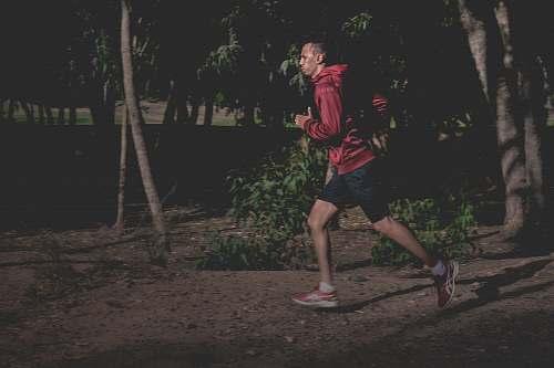 person man in red hoodie running people