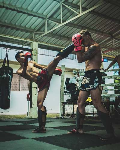 person man kicking man's head sport