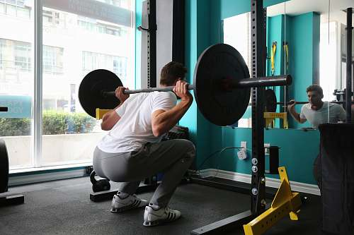 person man lifting barbel working out