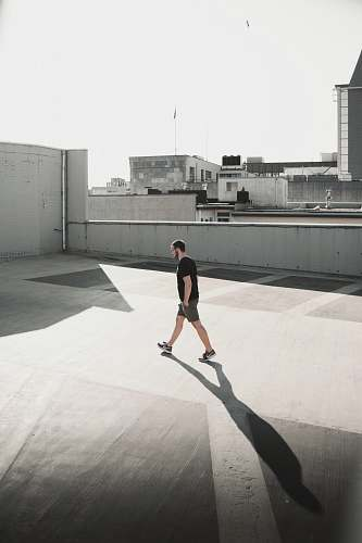 person man walking on building roof top people