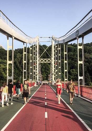 person people walking on bridge pedestrian