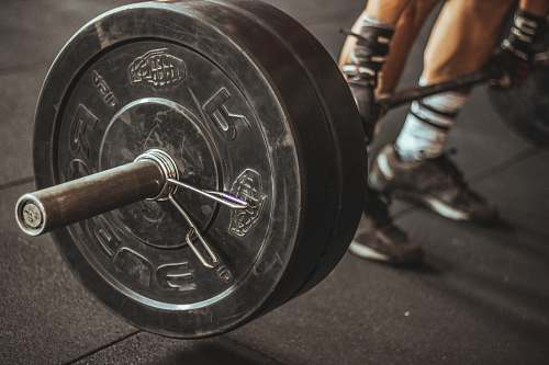 person person holding barbell people