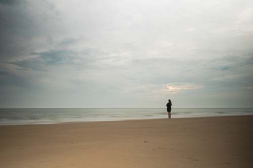person rule of thirds photography unknown person standing near body of water nature