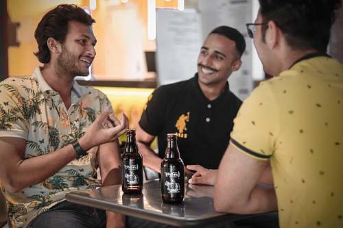 photo person three men drinking beer drink free for commercial use images