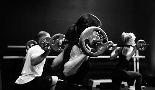 black-and-white three person lifting barbels sport