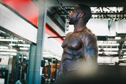 person topless man staring upward skin
