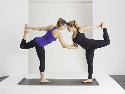 person two women doing yoga yoga