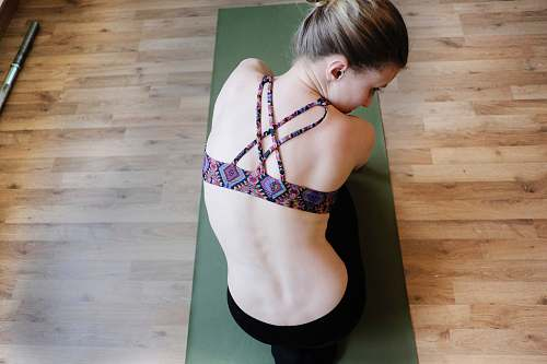 people woman in purple sports bra doing yoga person