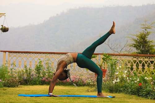 person woman in teal leggings posing yoga exercise