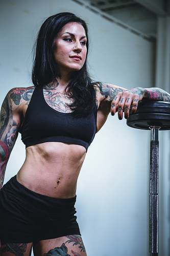 person woman leaning on black steel barbell people