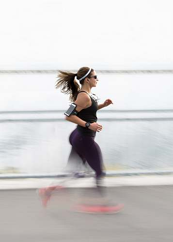 fitness woman running wearing armband people