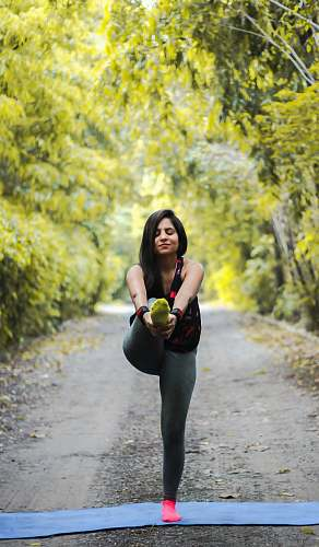 person woman standing and doing yoga vegetation