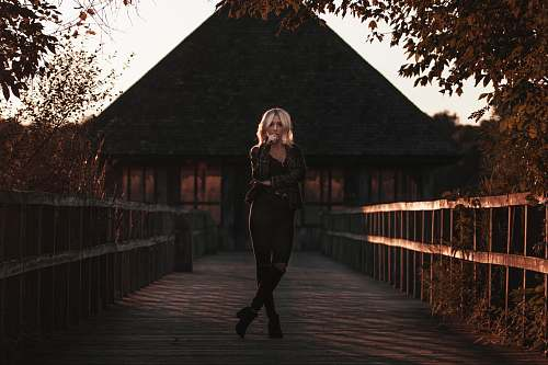 person woman standing on bridge people