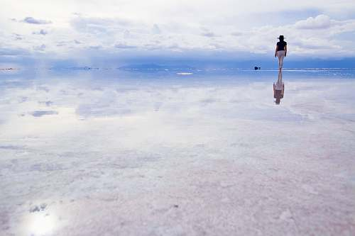 person woman standing on water during daytime nature