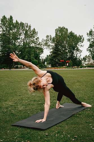 person woman stretching body on yoga mat exercise