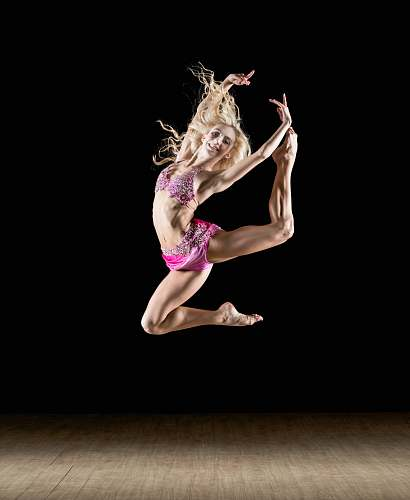 dance woman stretching her legs and arms in mid air people
