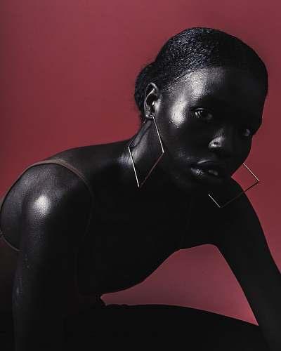 person woman wearing diamond earrings face