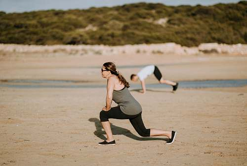 people woman wearing grey tank top doing exercise person