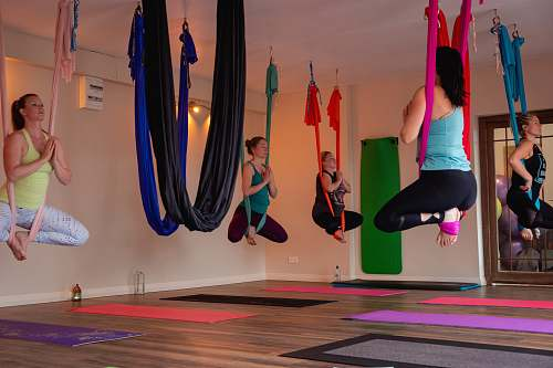 person women doing yoga inside room working out