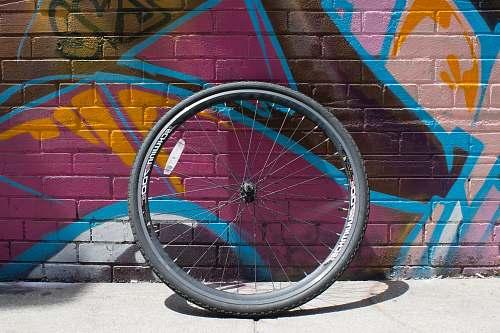 wheel black bicycle tire with rim graffiti