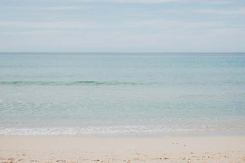ocean calm waters at the shore grey