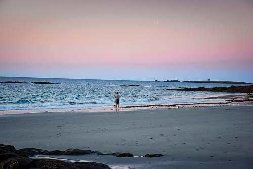 ocean person standing on shoreline sea