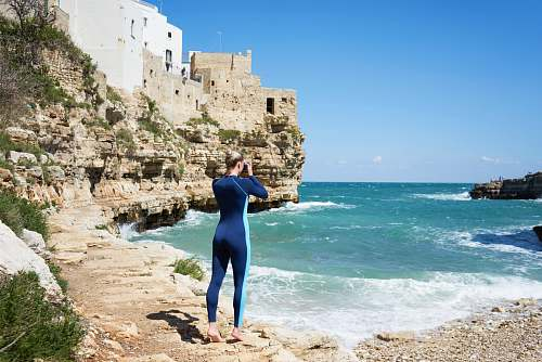 ocean woman standing near shore sea