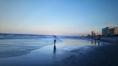 nature woman walking on seashore shoreline