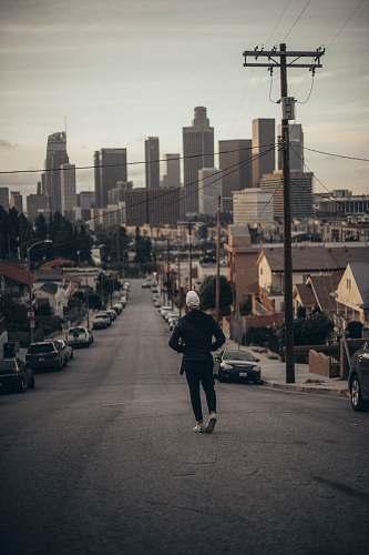 person man walking on road during daytime human