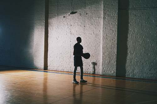 human man holding basketball person