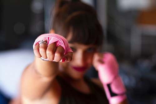 human focus photography of woman's fist people