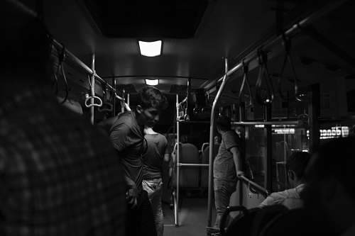 human grayscale photography of people inside train black-and-white